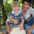 Stock Photo: Father and son in forest