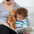Stock Photo: A mother reading to her son.