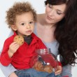 Cute child eating cookies - Stock Photo