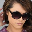 Fashionable woman with sunglasses — Stock Photo