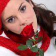 Woman holding red rose - Stock Photo