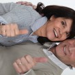 Mature couple thumbs up and all smiles — Stock Photo #14276597
