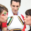 Three Italian soccer fans — Stock Photo