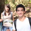 Young couple hiking through a forest - Lizenzfreies Foto