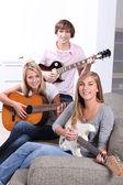 Teen playing guitar — Stock Photo
