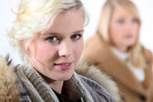 Two women in winter clothes. — Stock Photo