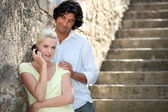 Couple by stone steps — Stock Photo