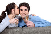 Couple with champagne glasses kissing — Stok fotoğraf