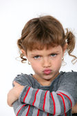 Angry little girl grinning — Stock Photo