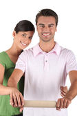 Couple with a rolling pin — Stock Photo