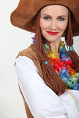 Woman in a hippy style fancy dress outfit — Stock Photo