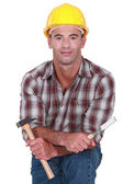 Carpenter stood with hammer and chisel — Stock Photo