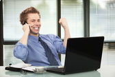 Happy businessman hearing good news on phone — Stock Photo