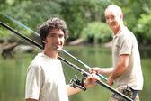 Men fishing at a lake — Stock Photo