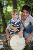 Father and son in a forest — Stock Photo