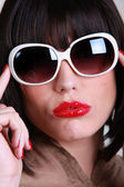 Woman wearing oversized sunglasses — Stock Photo