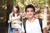Young couple hiking through a forest — Stock Photo
