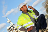 Traffic guard speaking into his walkie talkie — Stock Photo