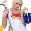 Foto Stock: Serious female house painter