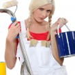 Serious female house painter — Stock Photo