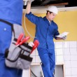 Plumbers at work - Stock Photo