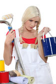 Serious female house painter — Stok fotoğraf