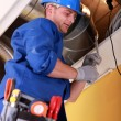 Worker repairing ventilation system — Stock Photo