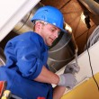 Men examining ventilation system - Stock Photo