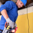 Man repairing complected ventilation system — Stock Photo