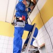 Stock Photo: Electrician on a ladder