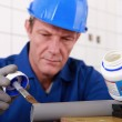 Plumber joining plastic pipe — Stock Photo #14551953