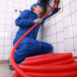 Plumber fixing some pipes - Stock Photo