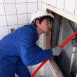 Stock Photo: Man fixing plumbing