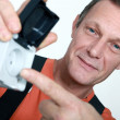 Electrician holding an exterior wall socket — Stock Photo #14552341