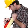 Stock Photo: Carpenter using wood plane