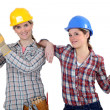 Female builders with timber — Stock Photo
