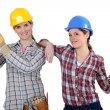 Female builders with timber — Stock Photo #14553489