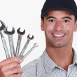 Man holding wrenches — Stock Photo #14553619