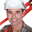Man resting cutting tool over shoulder — Stock Photo #14553639