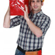 Foto Stock: Craftsman carrying tool box