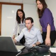 Director and assistants in office — Stockfoto
