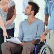 Man in wheelchair and assistant — Stock Photo