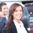 Businesswoman next to aircraft — Stock Photo #14555255