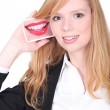 Redhead girl smiling with photo of a mouth — Stock Photo #14556313