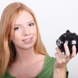 Portrait of a young woman with money box — Stock Photo #14556347
