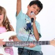 Two kids doing a rock band — Stock Photo