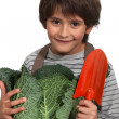 Stock Photo: Little boy with cauliflower