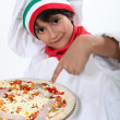 Pizza boy carrying a pizza — Stock Photo
