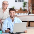 Stock Photo: Happy doing accounting at home