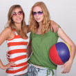 Girls equipped for the beach — Stock Photo